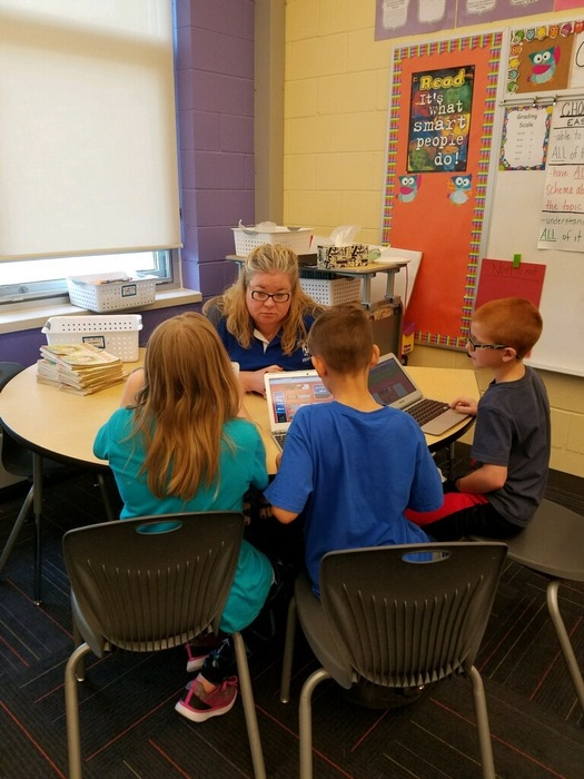 Mrs. Nichols working with students