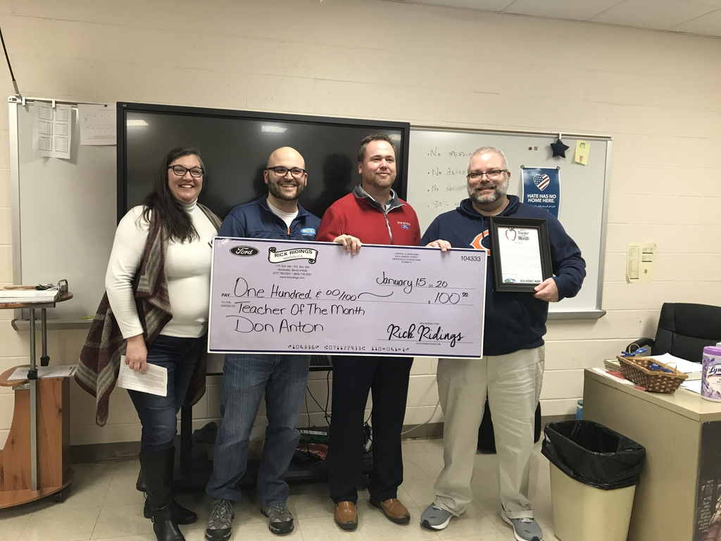 Don Anton being presented a big check by Tim and Sarah and Rick Ridings for being named Teacher of the Month.